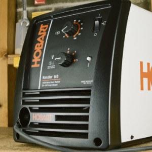 Hobart 140 MIG welder front control panel.