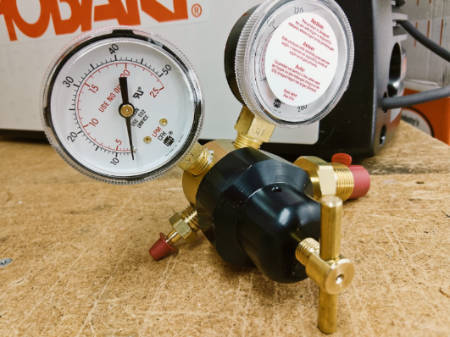 Gas regulator with dual gauges for Hobart welder.