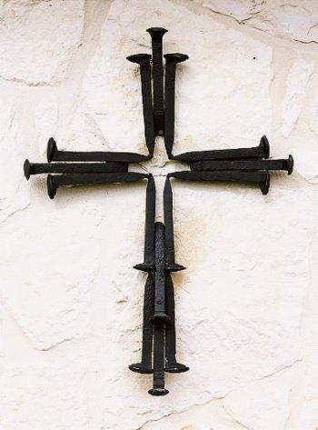 A cross welded from scrap railroad spikes.