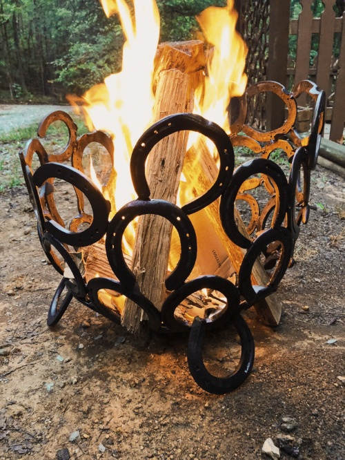 Horseshoes welded into an outdoor firepit.