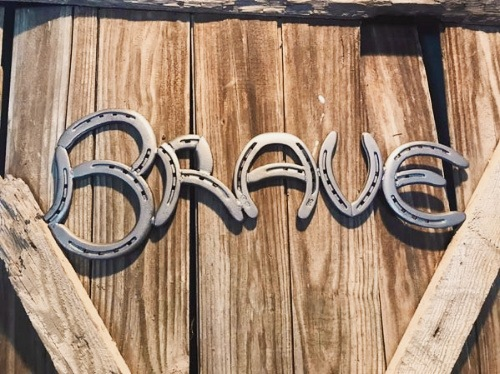 "The word ""Brave"" made from welded horseshoes."