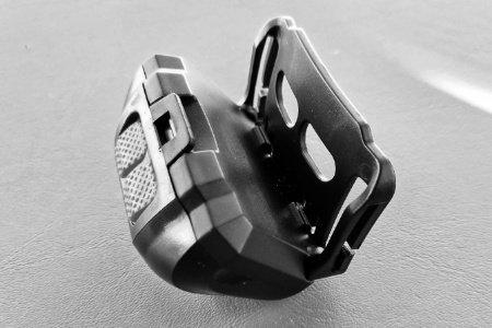 Headlamp pivoting headband holder allows use as a welding helmet light.