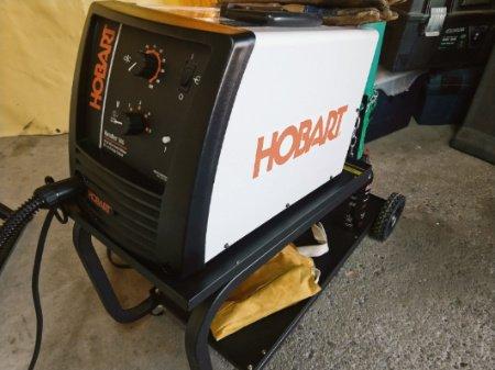 Hobart Handler 140 review with MIG welder on cart.